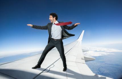 Businessman riding an airplane