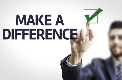 Business man pointing the text: Make a Difference